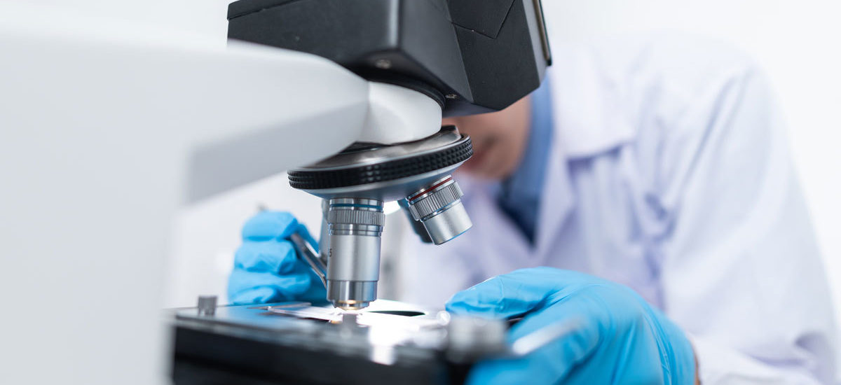 Pathologist using microscope